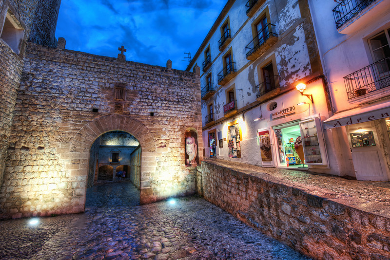 """<h2>Spanish Streets at Night</h2><br/>The old part of Ibiza is has a medieval layout where the inner city is ringed by a city curtain wall. Once inside, all the streets are narrow and twisty and lined with different kinds of stone. This looks back at the main entrance to the area.<br/><br/>I haven't spent as much time in some of these ancient old cities as I would like. There is a lot of satisfaction in setting up for shots in these areas. It's nice to take my time and compose this and that… I find great enjoyment in this!<br/><br/>- Trey Ratcliff<br/><br/><a href=""""http://www.stuckincustoms.com/2012/07/07/spanish-streets-at-night/"""" rel=""""nofollow"""">Click here to read the entire post at the Stuck in Customs blog.</a>"""
