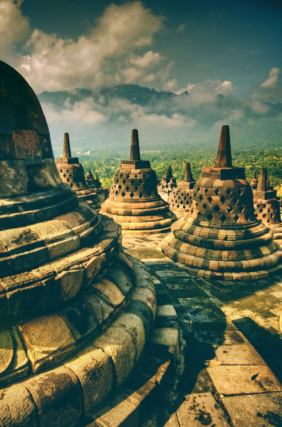 "<h2>Old Jogjakarta</h2> <br/>I visited this area of Jogjakarta day after day to get different light and different conditions. This is the old temple of Borobudur, and each of these ""bells"" is a stupa-cage that protects stone buddhas that sit inside.<br/><br/>I wanted to get a photo of the inside, but it's extremely difficult… so you'll just have to take my word for it! :)<br/><br/>- Trey Ratcliff<br/><br/><a href=""http://www.stuckincustoms.com/2011/12/25/old-jogjakarta/"" rel=""nofollow"">Click here to read the rest of this post at the Stuck in Customs blog.</a>"