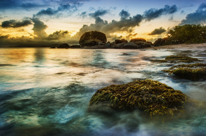 """<p><h2>The Swirling Seashore</h2></p>                  <p><br/>Every now and then you see some rocks along the coast that are not smooth, but covered with moss and clinging vegetation. It's kind of strange how nearby rocks are worn smooth and slick, while others, like this one below, look like they could be in some deep jungle freshwater river.<br/><br/>- Trey Ratcliff<br/><br/><a href=""""http://www.stuckincustoms.com/2012/10/23/the-swirling-seashore/"""" rel=""""nofollow"""">Click here to read the rest of this post at the Stuck in Customs blog.</a></p>"""