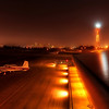 """<h2>One Plane Alone at the End of the Night</h2> <br/>Here we are at Santa Monica Airport deep in the night.  It was quiet.  And peaceful. <br/><br/>I spend a massive amount of time at airports.  I'm usually totally alone, and, most of the time, this is perfectly all right.  I've developed an ever-changing internal dialog that keeps me mentally stimulated at all times.  I'm glad no one can read my thoughts... surely they would find the cacophonous chorus to be the height of lunacy.  And then, when things finally bubble over, well, it is nice to have a kindred spirit around.<br/><br/>- Trey Ratcliff<br/><br/><a href=""""http://www.stuckincustoms.com/2010/04/01/one-plane-alone-at-the-end-of-the-night/"""" rel=""""nofollow"""">Click here to read the rest of this post at the Stuck in Customs blog.</a>"""