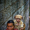 "<h2>Young Girl in Basket</h2> <br/>The main river that runs through Feng Huang and is criss-crossed by many bridges and walkways.  To get up to them, there are long stone stairways that switchback up the sides.<br/><br/>In the mornings, women go down to the river with their children to wash clothes.  As they go back and forth to get more loads, sometimes they put the babies into the baskets on the way up again.<br/><br/>- Trey Ratcliff<br/><br/><a href=""http://www.stuckincustoms.com/2011/04/12/young-girl-in-basket/"" rel=""nofollow"">Click here to read the rest of this post at the Stuck in Customs blog.</a>"
