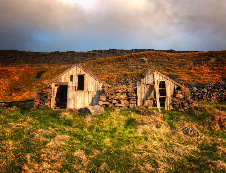 "<h2>Home in the Hillside</h2> <br/>Is it okay if I do two Iceland photos in a row?  I hope so, because I'm very excited about this one too.<br/><br/>Some of these places you can't see from the road.  If you walk over one hill and down another, you can find these wonderful little places tucked away in hillsides.  Even though it's all fallen apart, it's still charming... sort of a fixer-upper!<br/><br/>- Trey Ratcliff<br/><br/>Read the rest, including some news on the Android app, <a href=""http://www.stuckincustoms.com/2012/02/07/featured-in-android-market-and-google-tv/"">here</a> at the Stuck in Customs blog."