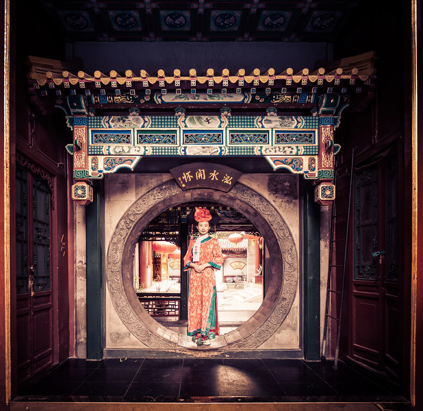 """<h2>Going Through the Portal</h2> <br/>Believe it or not, this woman was my waitress! <br/><br/>She brought Tom and I some richly decorated food, most of which we were not allowed to eat. It was a very strange day, actually. They invited us here for a very formal Chinese lunch, but they actually wanted me to take photos of the food, but I found her more interesting! She did end up bringing us some food we could finally eat. <br/><br/> Actually, she brought us some ground beef inside some bread and told us the history of the DragonLady. She went through this rich history about The DragonLady and how she got bored and decided to invent sliders. This is the short version of the story, of course! <br/><br/>- Trey Ratcliff<br/><br/><a href=""""http://www.stuckincustoms.com/2013/07/03/going-through-the-portal/"""" rel=""""nofollow"""">Click here to read the rest of this post at the Stuck in Customs blog.</a>"""
