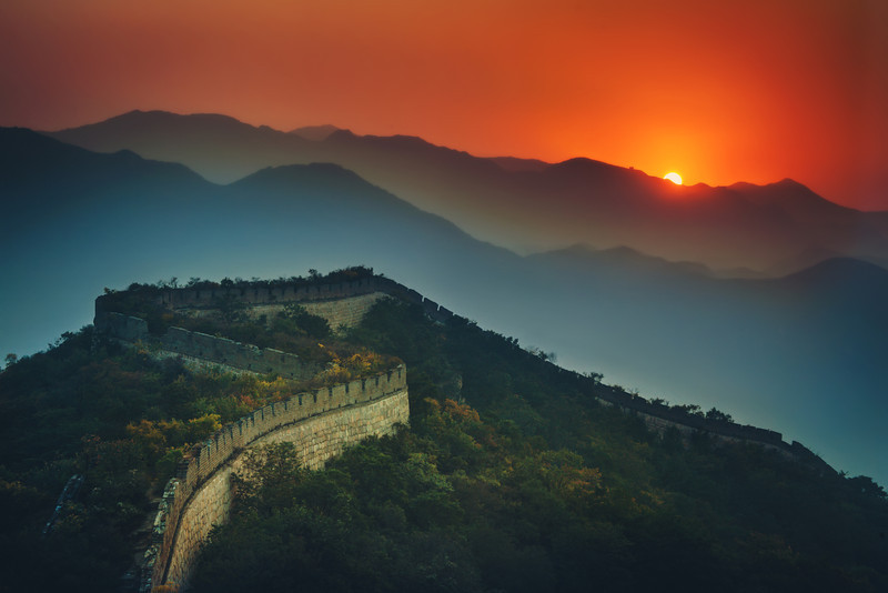 """<h2>The Great Wall Stretches Across the Sunset</h2><br/>Beautiful China! Isn't the Great Wall an awesome thing? It's so epic in every way. I do what I can to make it feel as epic as it deserves. On one of my nights there, the sun dipped halfway behind a hill. I saw it happening while I was walking along the wall by myself, so I set up for this shot…<br/><br/>- Trey Ratcliff<br/><br/><a href=""""http://www.stuckincustoms.com/2012/08/12/the-great-wall-stretches-across-the-sunset/"""" rel=""""nofollow"""">Click here to read the rest of the post at the Stuck in Customs blog.</a>"""