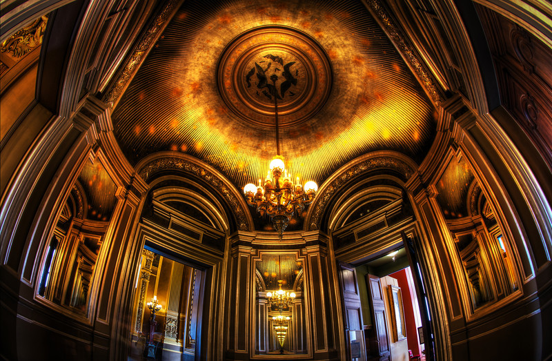 """<h2>The Mysterious Places of Paris</h2> <br/>Isn't this room amazing? It's not in the main part of the Paris Opera House, but it had the most ornate and Inception-esque room I've seen in a while. I took this photo while in the middle of experimenting with the Nikon fisheye lens. It seemed to fit the bill for these ornate grand locations that are still in a relatively confined space. <br/><br/>- Trey Ratcliff<br/><br/><a href=""""http://www.stuckincustoms.com/2012/11/28/new-nikon-fisheye-review/"""" rel=""""nofollow"""">Click here to read the rest of this post at the Stuck in Customs blog.</a>"""