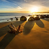 """<h2>Moeraki Boulders at Sunrise</h2> <br/>A group of people from NZIPP went out for an overnight road trip to this amazing place on the east coast. I've always wanted to shoot them at sunrise, but it kind of requires you to sleep pretty close by. I live in Queenstown, which is about 3-4 hours away, and that would mean a 2 AM wake-up time in the summer!<br/><br/>One of the tricky things about these boulders is ensuring you arrive at low-tide. At high-tide, they are almost totally inaccessible… so timing a sunrise with a low-tide takes a bit of planning. Thanks to Jason Law and NZIPP for the nice invite!<br/><br/>- Trey Ratcliff<br/><br/><a href=""""http://www.stuckincustoms.com/2012/12/01/road-trip-to-the-moeraki-boulders/"""" rel=""""nofollow"""">Click here to read the rest of this post at the Stuck in Customs blog.</a>"""