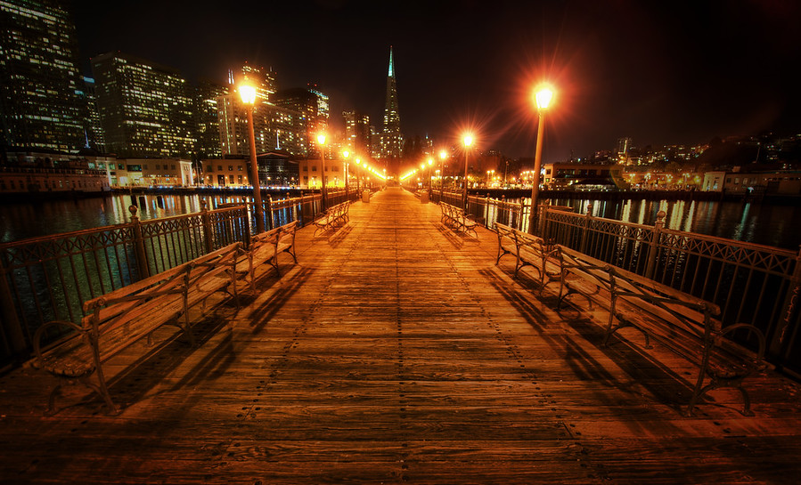 The Long DockOn one of my final nights in San Francisco, I walked out on the dock off the Embarcadero to see what I could see.  There were nice views in every direction, and one of the best was looking straight back up the dock at the Transamerica building.This wide-angle 14-24 lens is one of my favorites, but it does have one little problem that can also be an advantage.  It takes whatever is in the center of the frame and makes it quite small.  The opposite of that happens on the edges, where things get quite spread out.  So, I did that little trick here to help the Transamerica building to seem a bit taller.- Trey RatcliffRead the rest of this entry at the Stuck in Customs blog