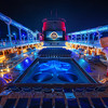 "<h2>Disney Fantasy Cruise - Tunnel Vision</h2> Here is one more photo from the Fantasy!  I've been going photo-crazy.  Not only is the cruise kind of expensive, but the internet costs 75 cents a minute... so, many Bothans died to bring you this image!  But... it is so amazing I wanted to share it ASAP.<br/><br/>See those tubes there on the right and left?  It's a huge waterslide that even extends out beyond the edges of the ship!  Amazing...  and that huge movie screen there?  They play movies on it regularly... so you can relax at the pool while seeing something more interesting than what always seems to end up on my airplanes:  Miss Congeniality 2.<br/><br/>- Trey Ratcliff<br/><br/><a href=""http://www.stuckincustoms.com/2012/04/05/disney-fantasy-cruise-tunnel-vision/"" rel=""nofollow"">Read the rest of this post at the Stuck in Customs blog.</a>"