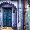 "<h2>The Purple Portal</h2> <br/>When I was in Agra, I wandered around the streets surrounding the Taj Mahal for a few hours.  The textures and details everywhere are an absolute field-day for photographers!  There is so much to see and capture...  it was totally overwhelming trying to grab all of that, while still thinking about getting into the Taj Mahal for another full slate of shooting!<br/><br/>So many of the little homes here are richly painted in every possible shade in the most interesting textures and shapes.  This is one of many little snaps I got while walking around.<br/><br/>- Trey Ratcliff<br/><br/><a href=""http://www.stuckincustoms.com/2010/04/14/the-purple-portal/"" rel=""nofollow"">Click here to read the rest of this post at the Stuck in Customs blog.</a>"