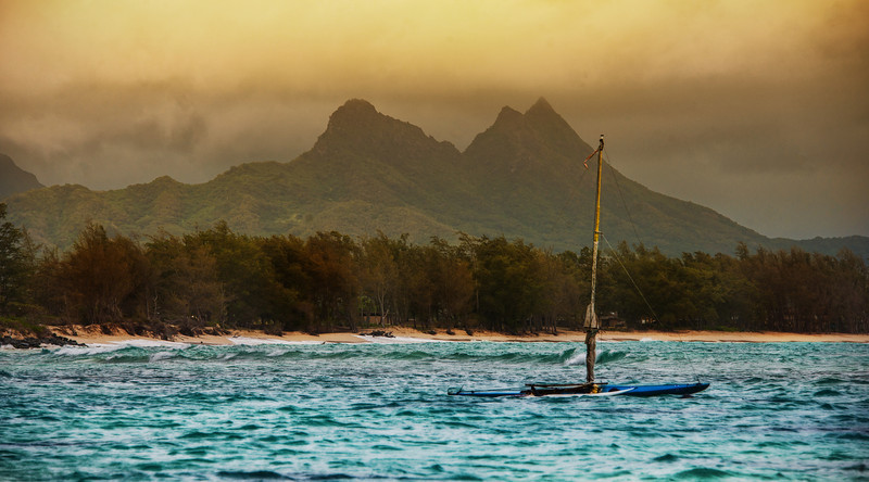 """<h2>Boat in Oahu</h2> <br/>I waded out into the lukewarm water with my tripod to get this scene. I never had taken my tripod into water before like this, so I did not expect it to fill up with water. I guess it makes sense, upon reflection. And it turns out that it is a gift that keeps on giving. For weeks and weeks after this move, whenever I launch my tripod over my shoulder, I can still hear the water rolling back and forth through the tubes. <br/><br/>- Trey Ratcliff<br/><br/><a href=""""http://www.stuckincustoms.com/2012/10/15/smugmug-new-coupon/"""" rel=""""nofollow"""">Click here to read the rest of this post at the Stuck in Customs blog.</a>"""