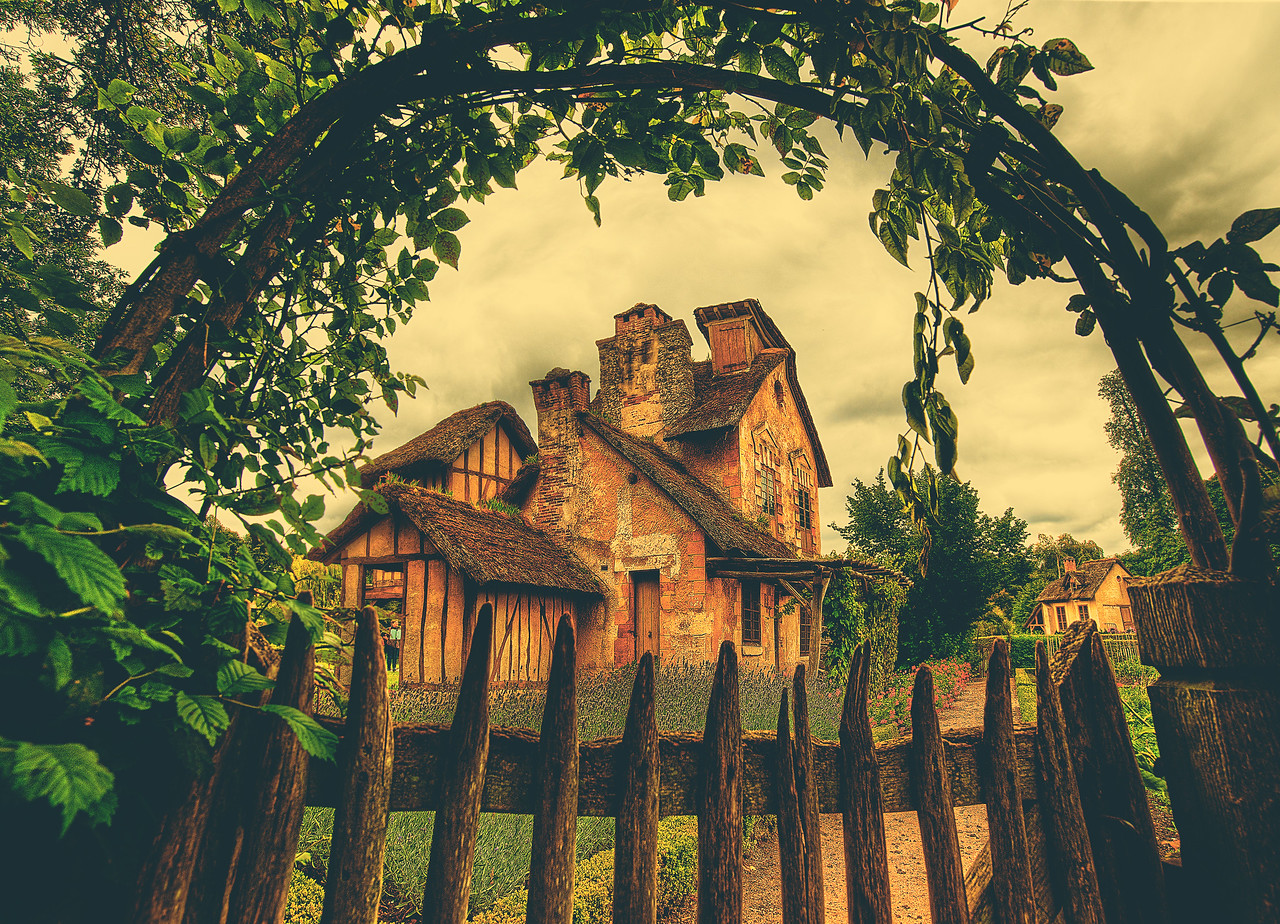 Country Home in French Meadow This beautiful little country home sits in the meadows and gardens of Versailles. I've taken a few photos around this estate, and I really like this arch with the ivy.  It made me want to have an arch with ivy at my own house!This was taken with the trusty old 14-24mm lens from Nikon. I tend to use this lens about 30% of the time I think. Most of the time nowadays, I use the 28-300mm with a few percentage points in there for the 50mm and 85mm prime.- Trey RatcliffClick here to read the rest of the entry at the Stuck in Customs blog.
