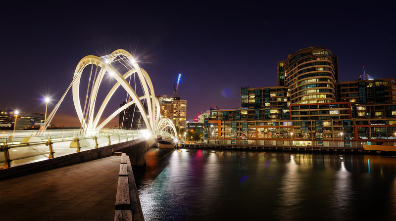 """<h2>Another Bridge in Melbourne</h2> <br/>I like these cities that get all fancy with their bridges. Melbourne certainly does! Each bridge tries to out-do the next. There's no common theme and its sort of a mish-mash of styles, to say the least. I think that not everyone likes this, but I do. I don't mind all the variety, especially from the perspective of photography.<br/><br/>It's kind of the same way with the buildings and other decorative elements around downtown Melbourne. There are so many styles, most of which are one flavor of """"modern"""" or """"contemporary"""". I enjoy mixing and matching different elements into compositions, but it is not easy. There is a challenging aspect to it that I don't get in many other cities.<br/><br/>- Trey Ratcliff<br/><br/><a href=""""http://www.stuckincustoms.com/2013/04/12/another-bridge-in-melbourne/"""" rel=""""nofollow"""">Click here to read the rest of this post at the Stuck in Customs blog.</a>"""