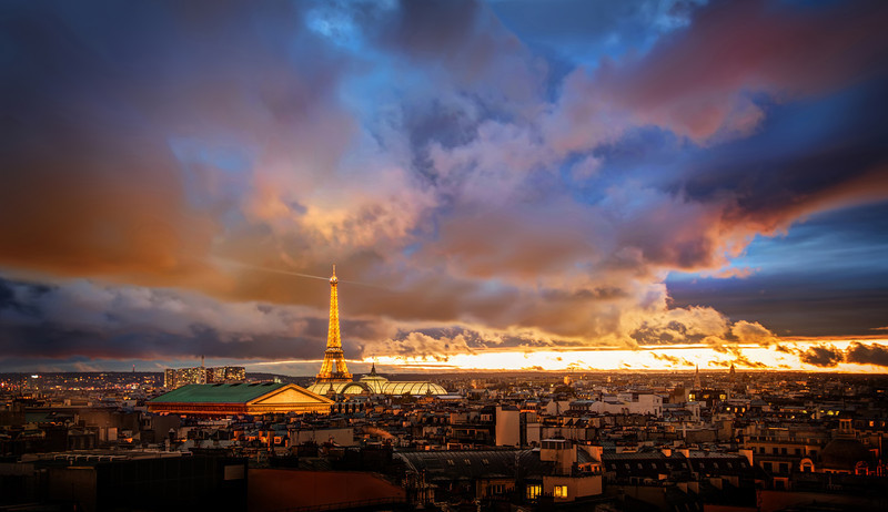 """<h2>The Amazing Eiffel Tower in Romantic Paris</h2> <br/>I shot this just recently with Tom Anderson. We almost didn't leave the hotel because it was so stormy, but we had been watching the clouds all day. We started out with Miss Aniela at the Paris Opera before exploring the rest of the city. Sunset comes early here around this time of the year (about 5 PM or so), and it always sneaks up on us.<br/><br/>Some of the best sunsets come right after storms… so it's always worth a little adventure if you don't mind getting a little wet… <br/><br/>- Trey Ratcliff<br/><br/><a href=""""http://www.stuckincustoms.com/2012/11/27/what-prints-hang-in-my-home/"""" rel=""""nofollow"""">Click here to read the rest of this post at the Stuck in Customs blog.</a>"""