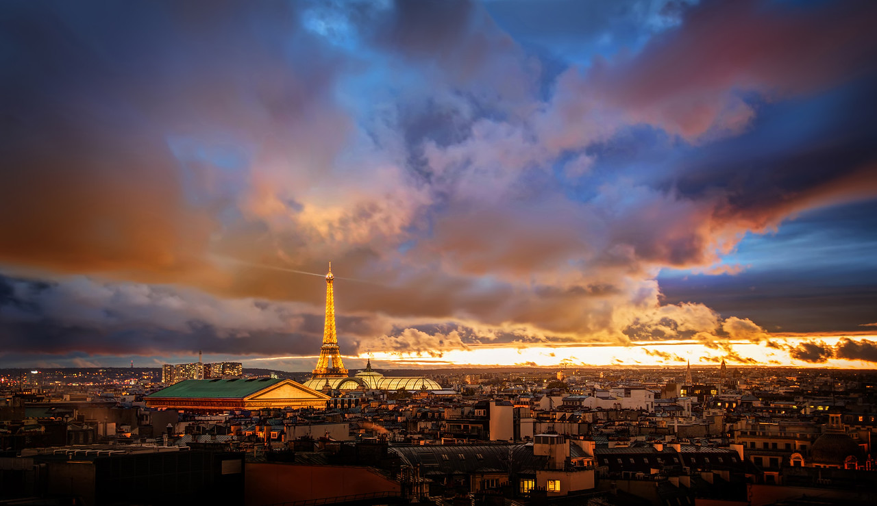 The Amazing Eiffel Tower in Romantic Paris I shot this just recently with Tom Anderson. We almost didn't leave the hotel because it was so stormy, but we had been watching the clouds all day. We started out with Miss Aniela at the Paris Opera before exploring the rest of the city. Sunset comes early here around this time of the year (about 5 PM or so), and it always sneaks up on us.Some of the best sunsets come right after storms… so it's always worth a little adventure if you don't mind getting a little wet… - Trey RatcliffClick here to read the rest of this post at the Stuck in Customs blog.