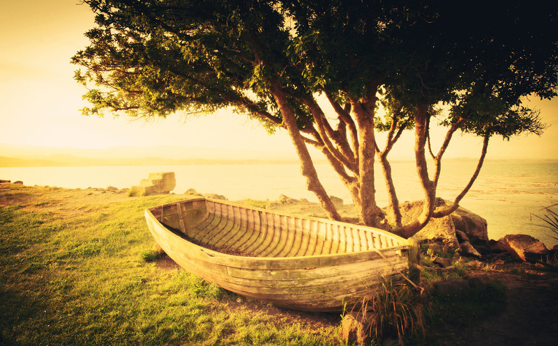 """<h2>Old Boat by the Seashore</h2> <br/>I was near Moeraki and taking photos at sunset. This was the only night I was there, and I was excited to eat at this legendary place I keep hearing about called """"Fleur's"""" — so I was extra-bummed to find out it happened to be closed on that one night in particular. What a bummer. But I walked around the back side to explore and saw this boat up by this tree…<br/><br/>- Trey Ratcliff<br/><br/><a href=""""http://www.stuckincustoms.com/2013/07/15/old-boat-by-the-seashore/"""" rel=""""nofollow"""">Click here to read the rest of this post at the Stuck in Customs blog.</a>"""