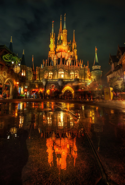 """<h2>Where the Princess Dwells at Night…</h2> I called for a little PhotoWalk at Disney! It was really really really fun - and getting this shot was tough! I think +<a href=""""https://plus.google.com/103878115150490505546"""">William Beem</a> +<a href=""""https://plus.google.com/100980643623677833022"""">Gilmar Smith</a> +<a href=""""https://plus.google.com/105248484118148978714"""">Keith Barrett</a> or perhaps +<a href=""""https://plus.google.com/111852119488463725230"""">Ali Elhajj</a> got a video of me trying to convince half a dozen Disney workers to """"sweep water"""" in front of my camera, which was splayed on the ground. At first, one guy didn't want to do it because he might get in trouble... then the other acquiesced... and then, before they knew it, they were all being controlled like crystal farmers in Starcraft... we eventually got all the water in the right place!<br/><br/>I had to go over and whip out my sweet Android phone to show them some photos from Google+ -- I found the one from Paris with the puddle - I said I needed a puddle about <em>thiiiiis big</em> … and eventually we got it all engineered out. They were all very helpful and nice… I convinced them all to come onto Google+ to see the final result -- so I hope they are here! Hi guys - Y muchas gracias!<br/><br/>- Trey Ratcliff<br/><br/><a href=""""http://www.stuckincustoms.com/2012/04/01/where-the-princess-dwells-at-night/"""" rel=""""nofollow"""">Read the rest at the Stuck in Customs blog.</a>"""