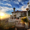 "<h2>Sunset at Hearst Castle</h2> <br/>Maybe people in California get spoiled by good sunsets.  Not living there, I don't know!  But, when you are sitting up high on a mountain, in a castle-mansion, overlooking the Pacific Ocean, how could you not get spoiled?<br/><br/>And this isn't even the main castle.  This is just one of the guest-houses.  Hearst had several guest houses there, each one as stunning as the next.<br/><br/>If you are enjoying these Hearst photos, I've now published six so far.  You can see all the <a href=""http://www.stuckincustoms.com/category/travel/california/hearst-castle/"">Hearst Castle Photos</a>.  Note:  These are also accessible via the ""Categories"" down on the right side of the page.<br/><br/>- Trey Ratcliff<br/><br/><a href=""http://www.stuckincustoms.com/2010/05/28/sunset-at-hearst-castle/"" rel=""nofollow"">Click here to read the rest of this post at the Stuck in Customs blog.</a>"