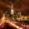 """<h2>Crossing the Bridge into Old Lyon</h2> <br/><br/>This was a pretty tough shot to get! This was a little pedestrian bridge that crossed from the new part of Lyon, France, into the older part. It swayed and buckled in the breeze. Plus, it was night, so you kind of have to leave the shutter open for a long time. I hate to crank up the ISO, but I had to so everything would stay sharp.<br/><br/>That night I walked around for about five hours deep past midnight. It was just me and my Russian friend... walking around... solving the world's problems... while he gave me all kinds of hard-ass Russian advice on how to solve my own!<br/><br/>- Trey Ratcliff<br/><br/><a href=""""http://www.stuckincustoms.com/2009/11/13/crossing-the-bridge-into-old-lyon-and-the-hdr-workshop-registration-open/"""" rel=""""nofollow"""">Click here to read the rest of this post at the Stuck in Customs blog.</a>"""