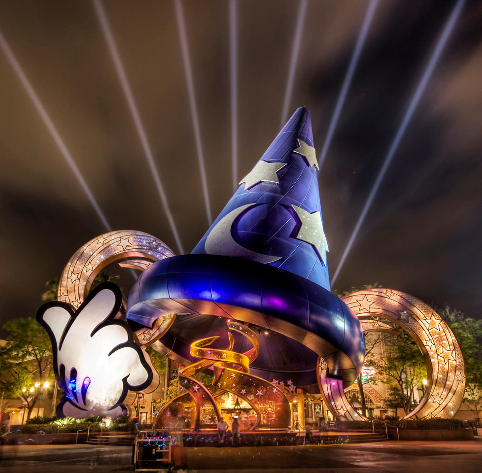 The Magic of Disney If you want to see how I made this (and how you can too!), visit my HDR Tutorial. I hope it gives you some new tricks!This was taken this evening at MGM Studios in Disney World before we went to go see the big fireworks show. The only problem with making your family and 6-year-old son (he is now 8) stand around while you set up your tripod and take a bunch of shots is that it gives them ample opportunity to see little toys they cannot live without.I took so long to nail this shot that we ended up buying two things that lit up in garish colors and made a lot of racket.This is a 5 exposure HDR shot at 100 ISO. Whenever there is anything like streaming lights, sun rays, search lights, and the like, the HDR process always makes them pop a bit.- Trey RatcliffClick here to read the rest of this post at the Stuck in Customs blog.