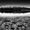 """<h2>The Rocks Near and Far</h2><br/>A few nights ago I went for a walk along the water's edge here in Queenstown. About one out of ten nights (or, as far as I have measured), there is a clear night with a bright pink light that shoots up from behind those mountains. It's really quite a sight.<br/><br/>I went down to the edge of the lake and buried my tripod legs in the frigid, icy-clear water. Even though the color of the light was so nice, in the end it was not as interesting as the light itself.<br/><br/>- Trey Ratcliff<br/><br/><a href=""""http://www.stuckincustoms.com/2012/06/24/the-rocks-near-and-far/"""" rel=""""nofollow"""">Read the entire post at the Stuck in Customs blog.</a>"""